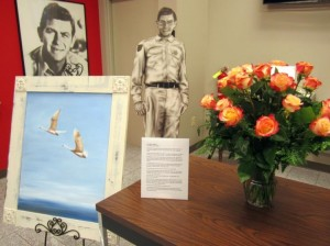 "This photo is of the lobby of the Andy Griffith Museum the week after Emmett died. The Museum says this about the painting in the photo: ""Cindi (Mrs. Andy) Griffith sent this painting by Lee Mims, a North Carolina artist, to Emmett before Christmas. To Cindi, the swans in the painting represent Emmett and Barbara Forrest– flying toward heaven."" Photo by Hobart Jones."