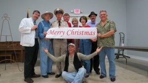 "Maggie Peterson (center) and Rodney Dillard (far right) share holiday greetings with help from fans Tom and Shirley Ditt (either side of Maggie) and tribute artists Allan ""Floyd"" Newsome, Bob ""Briscoe"" Mundy, David ""Mayberry Deputy"" Browning, Jeff ""Howard"" Branch and Phil ""Ernest T."" Fox."