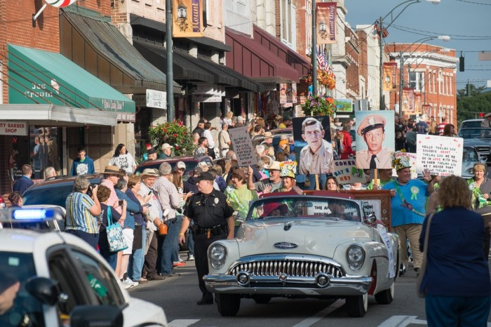 Betty Lynn (wearing red hat in car), as Grand Marshal of the Mayberry Days parade.