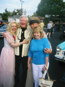 James Best enjoys a group hug with Mayberry Days Pork Queen Patty Browning, Mayberry Deputy David Browning and Best wife Dorothy.
