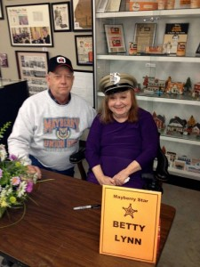 DON'T WEAR MY HAT, THEL!–Ted Womack with Betty Lynn, who's wearing his Mayberry Deputy hat during her autograph session at the Andy Griffith Museum in January. (Well, O.K., you can wear my hat, but just this once.)