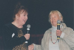 FUN TV COUSINS--Betty Lynn and Mary Grace enjoy a moment on stage together at Judge Joel Laird's Mayberry Cast Reunion event in Pelham, Ala., in October 2000.