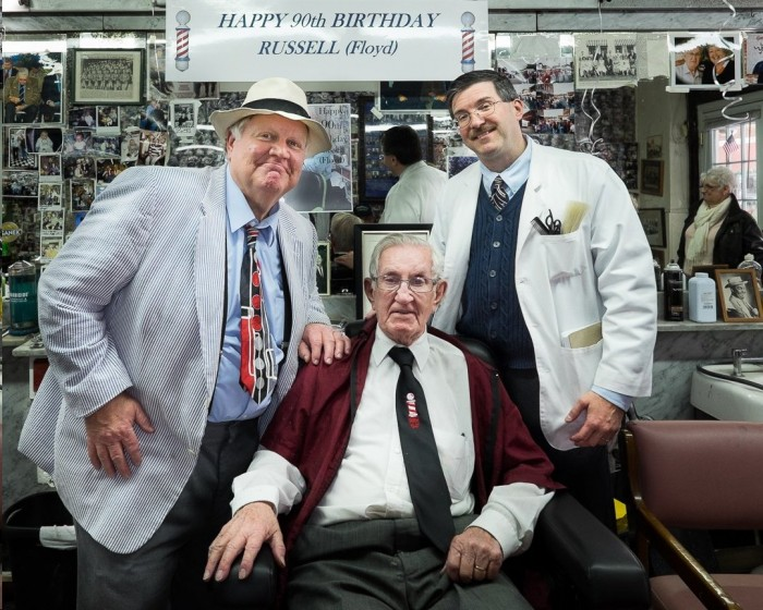 "Legendary Mount Airy barber Russell Hiatt at his 90th birthday party in January with Kenneth ""Otis"" Junkin and Allan ""Younger Floyd"" Newsome.  Russell has recently been under the weather, but he's doing better now, and all his friends and customers hope he'll soon be back in his Floyd's City Barber Shop.  Photo by Hobart Jones."
