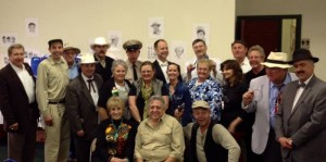 Maggie Peterson and Rodney Dillard (seated in front) are surrounded by tribute artists, festival organizers and fans at Mayberry in the Midwest in Danville, Ind.