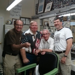 "CHEERY GROUP AND A CHAIR--Russell Hiatt enjoys a visit with incognito friends Tim ""Goober "" Pettigrew, Kenneth ""Otis"" Junkin and Allan ""Floyd Jr."" when the trio popped in for visit after breakfast at the Snappy Lunch on Aug. 22.  Photo tweeted by Allan."
