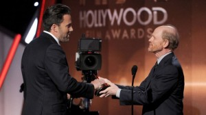 "HAPPY HAND-OFF–Ron Howard presents Ben Affleck the Hollywood Film Award for ""Gone Girl"" at November's Hollywood Film Awards…in Hollywood."