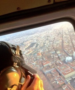 "Ron Howard tweeted this photo of himself scouting"" Inferno"" camera shots from a helicopter over Florence, Italy. Follow Ron on Twitter @RealRonHoward."