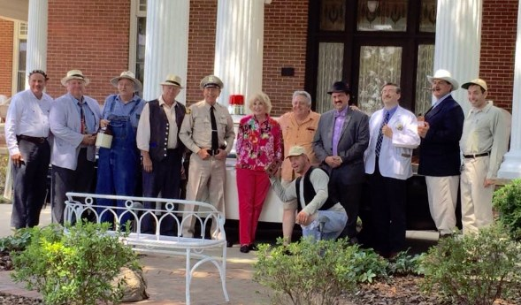 PILLARS OF MAYBERRY--Maggie Peterson and Rodney Dillard pose by posts with the Mayberry tribute artists squad during their visit to Troy, N.C., for the DARE fundraiser in August.