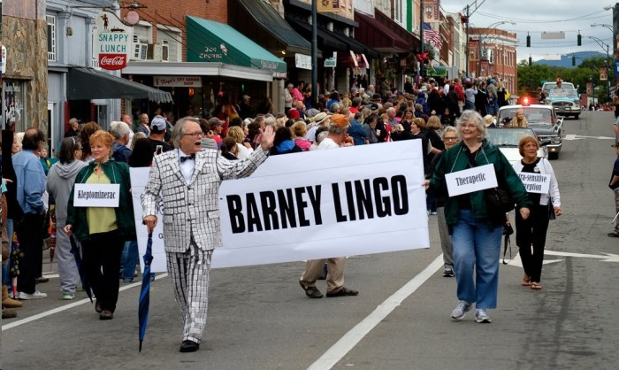 JUST SO YOU CAN SEE THE ARTIST BEHIND THE NOTECARDS--Mike Johnson leads the contingent from Barney chapter (Greensboro, N.C.) in this September's Mayberry Days parade. For those not there to see it in person, we should note that Mike's homemade salt and pepper suit is covered with actual tiny packets of salt and pepper. Thousands of them! And one nut, who's wearing them all. Somebody has way yonder too much time on his hands...which made for lots of big smiles. Photo by Hobart Jones.