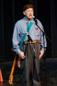 YO!--George Lindsey Jr. on stage at Colonel Tim's Talent Time. He's seen here wearing some of his his father's Goober wardrobe. Photo by Hobart Jones.