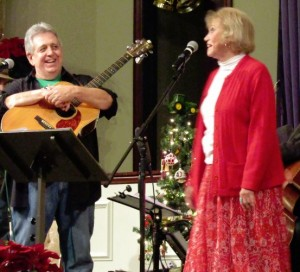 "JOLLY TIME--Rodney Dillard and Maggie Peterson onstage with their ""Mayberry Christmas"" show in Mt. Juliet, Tenn., in December."