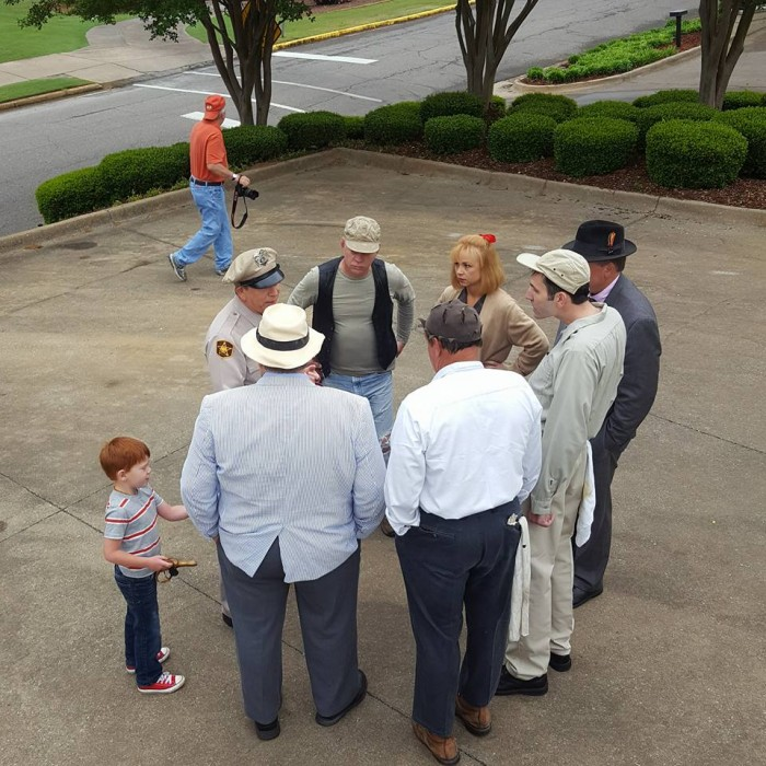 MAYBERRY RINGLEADERS--The team of tribute artists huddle to discuss their next play at the Eagles' Wings fundraiser in Tuscaloosa last week.