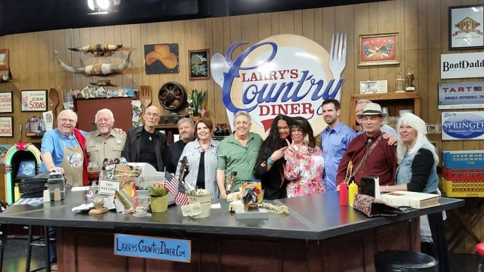 "EATIN' SPEAKS LOUDER THAN WORDS--Rodney Dillard (green shirt) and the Dillards band are surrounded by and mingled among the cast of ""Larry's Country Diner"" during a taping earlier this month in Nashville."