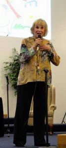 CHEERY SINGER--Maggie Peterson performing during the Missouri Cherry Blossom Festival in April.