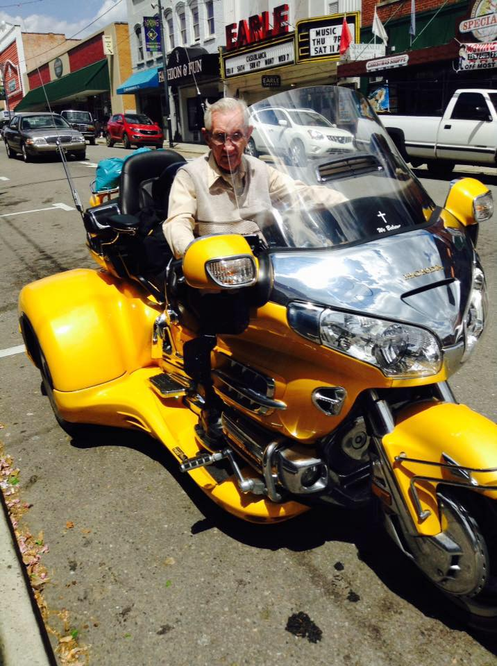 BEEP-BEEP! OUTTA THE WAY, SUNDAY DRIVER!-- Russell is ready to fly on a Gold Wing on the street outside his shop in 2014. Photo by Bill Hiatt.
